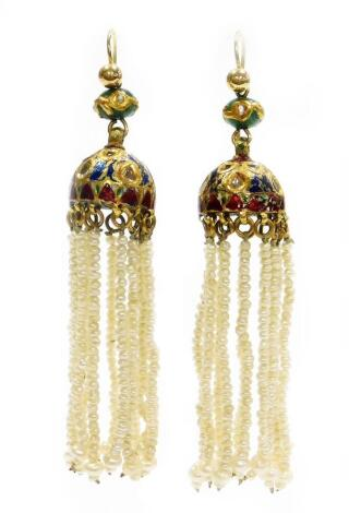 A pair of Indian drop earrings, each with enamel and paste stone set drop earring head, with various seed pearl strands, on yellow metal unmarked, 6cm long, 20.1g all in, boxed. (AF)