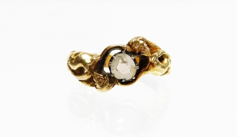 A modern dress ring, depicting two mermaids holding a central imitation diamond, on a yellow metal band, unmarked, ring size P, 7.5g all in.
