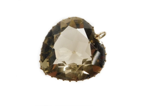 A smoky quartz heart shaped pendant, in a pierced design basket frame, yellow metal unmarked, 3cm x 3cm, 17g all in.