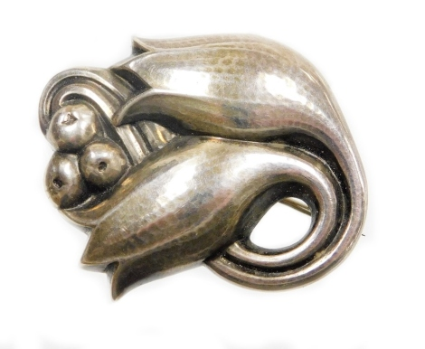 A Georg Jensen Danish silver brooch, of two flower buds and berries, bearing UK hallmark and numbered 100C, 4.5cm wide.