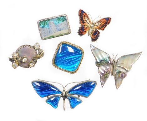 A group of butterfly wing and other brooches, comprising a silver plated blue butterfly wing butterfly brooch, 6cm wide, an imitation butterfly wing diamond shaped brooch, 3cm wide, a mother of pearl inlaid Mexican silver butterfly brooch, 4cm wide, a sil