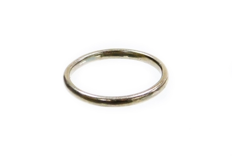 A platinum wedding band, of plain design with makers stamp WW Limited, marked platinum, ring size O½, 3.7g all in.