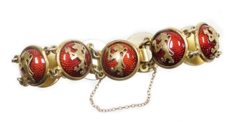 A Continental enamelled cabochon link bracelet, the bracelet formed of various circular links, each raised and finished in red enamel and applied with a rampant lion motif, with safety chain, the clasp stamped O.H.R, white metal marked 830S, approx 20cm l