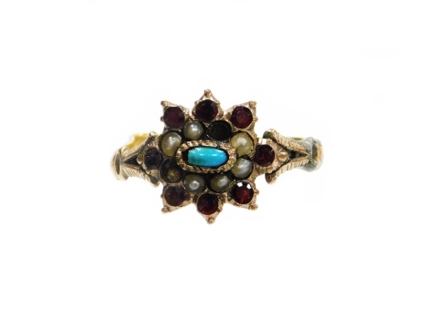 A Victorian dress ring, the centre set with garnets, seed pearls and a turquoise, on V splayed shoulders and a later misshapen yellow metal band, the band is made up of a split 22ct gold wedding band and crudely applied to the later ring setting which is