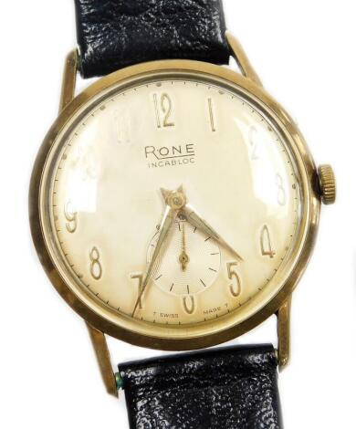 A Rone gentleman's wristwatch, with silver coloured dial, in a yellow metal casing, unmarked, on a later black leather strap with gold plated end, the watch head 3.5cm wide, and the watch 23cm high overall.