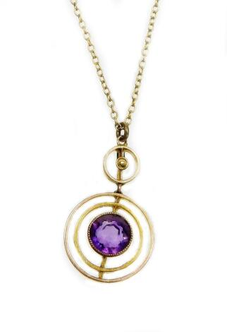 A 9ct gold pendant and chain, the small two tier circular pendant set with amethyst and seed pearls, 1.7cm diameter, on a fine link chain, 40cm long overall, 2.3g all in.
