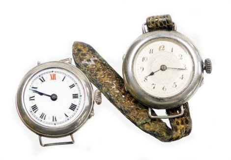 Two silver cased wristwatches, to include one with white enamel dial, gold marker points, with a Swiss movement stamped 925, lacking glass, another with silvered coloured dial, and bearing the inscription Margaret A Gray, makers stamp CN, with Swiss movem