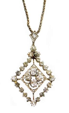A Victorian/Edwardian diamond pendant, the lozenge shaped pendant set with rose cut diamonds, of varying size, the centre section approx 0.42cts, surrounded by sixteen smaller diamonds each approx 0.05cts, with larger diamond to each point and three to th