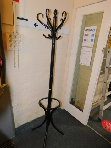 A mid 20thC ebonised hat and coat stand, 183cm high. (AF)