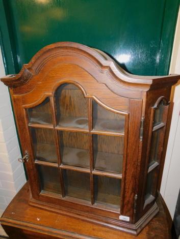 An oak wall hanging display cabinet, enclosing three shelves, 68cm high, 68cm wide, 17cm deep.