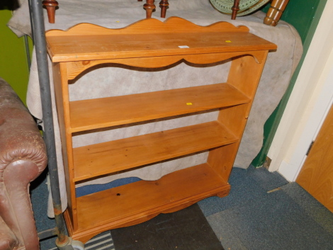 A pine bookcase, enclosing two fixed shelves, 98cm high, 92cm wide, 21cm deep.