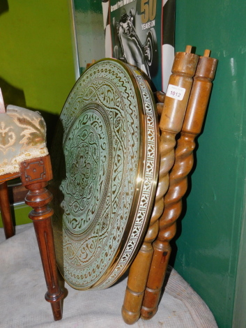 A brass top occasional table, with folding barley twist base, 81cm high, 60cm diameter.