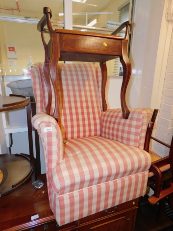 A mid 20thC armchair, upholstered in red and white checkered fabric, together with an Edwardian mahogany piano stool. (2) The upholstery in this lot does not comply with the 1988 (Fire & Fire Furnishing) Regulations, unless sold to a known exporter or uph