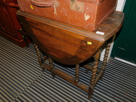 An oak barley twist drop leaf table, 72cm high, 38cm wide, 108cm extended, 75cm deep.
