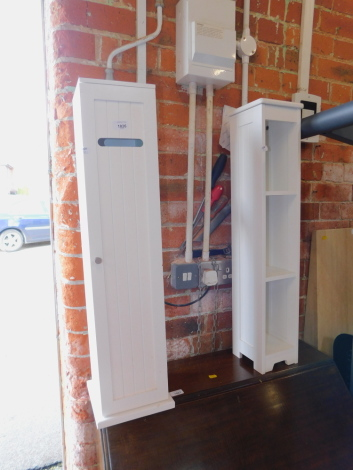 A narrow white painted bathroom cupboard, together with a matching shelf unit, each 80cm high, 20cm wide, 20cm deep. (2)