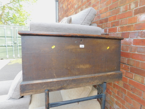 A Victorian stained pine blanket chest, with iron handle, 43cm high, 90cm wide, 47cm deep.