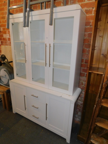 A white matt finish display cabinet, above three drawers and two cupboard doors, 189cm high, 130cm wide, 41cm deep.