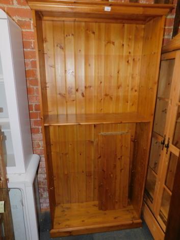 A pine bookcase, enclosing four adjustable shelves, 198cm high, 97cm wide, 34cm deep.