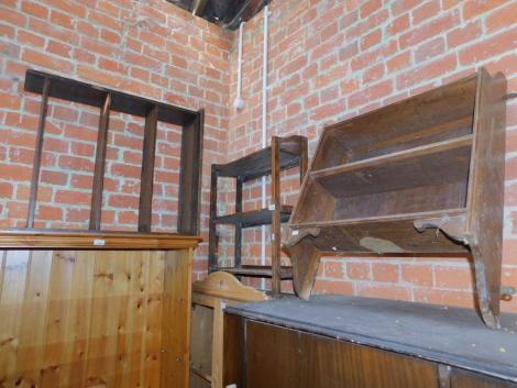 Three oak bookshelves, including one wall hanging shelf.