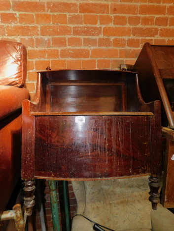 A Victorian mahogany two tier commode, raised on turned legs, 72cm high, 58cm wide, 50cm deep.