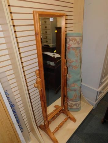 A pine cheval mirror, 148cm high.