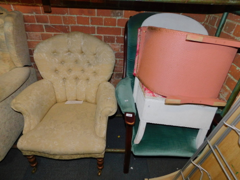 A Victorian style armchair, together with another armchair, Lloyd Loom style ottoman and a bedroom chair. (4) The upholstery in this lot does not comply with the 1988 (Fire & Fire Furnishing) Regulations, unless sold to a known exporter or upholsterer it