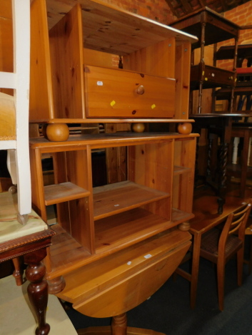A beech drop leaf kitchen table, together with two pine television stands. (3)