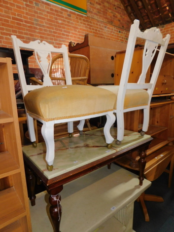 A pair of painted Victorian nursing chairs, together with an onyx effect coffee table, 46cm high, 94cm wide, 51cm deep. (3)