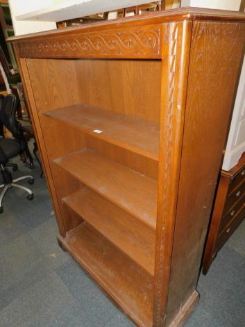 A Jaycee dark oak bookcase, enclosing three adjustable shelves, 141cm high, 98cm wide, 35cm deep.