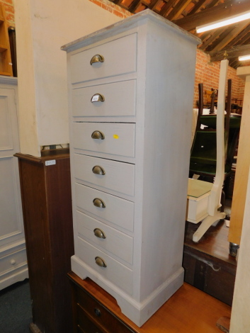 A grey painted narrow chest of seven drawers, with cup handles, 113cm high, 49cm wide, 34cm deep.
