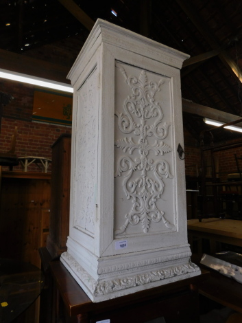 A reproduction painted pine pot cupboard, with carved decoration, 75cm high, 37cm wide, 36cm deep.