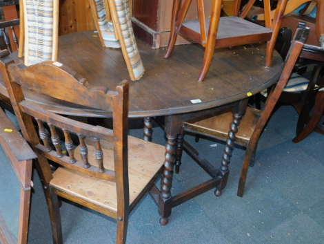 An oak barley twist drop leaf dining table, 73cm high, 146cm wide, 104cm deep, together with four Victorian dining chairs. (5)