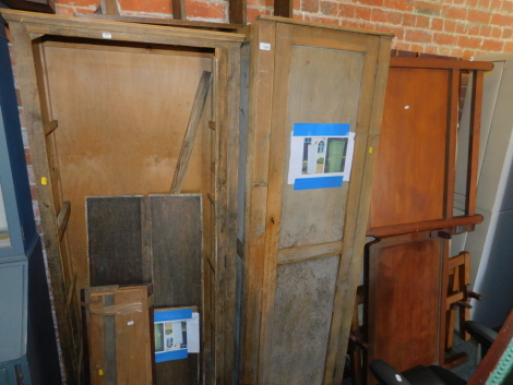 Two pine framed cupboards, together with two single bed frames. (4)