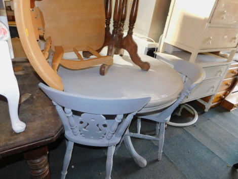 A pine circular kitchen table, painted blue, 75cm high, 105cm diameter, together with four chairs and a carver. (6)
