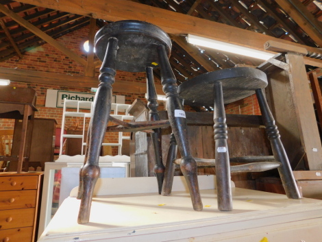 Two stained beech 19thC stools, with turned legs.