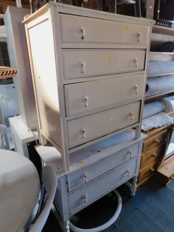 A painted chest of four drawers, 95cm high, 77cm wide, 46cm deep, together with a similar painted dressing table, with two drawers, 145cm high,. 92cm wide, 46cm deep. (2)