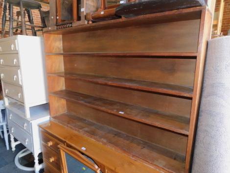 A long and narrow pine bookcase, enclosing three fixed shelves, 101cm high, 155cm wide, 24cm deep.