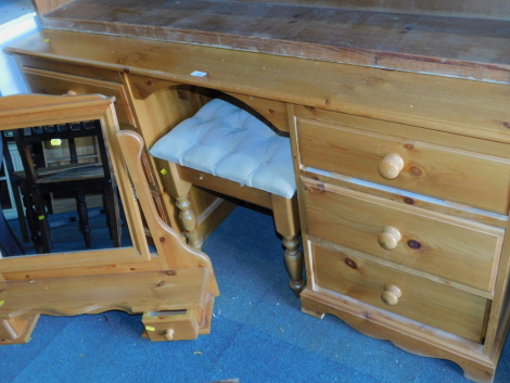 A pine dressing table, with six drawers, 72cm high, 153cm wide, 43cm deep, swing frame mirror and a stool. (3)