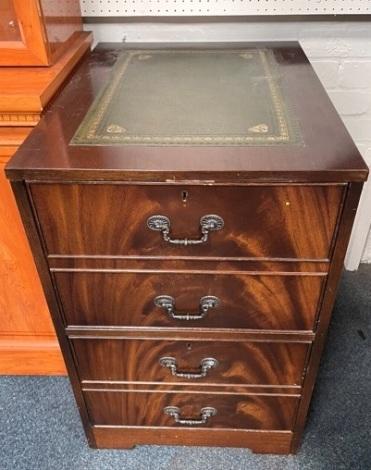 A mahogany desk pedestal