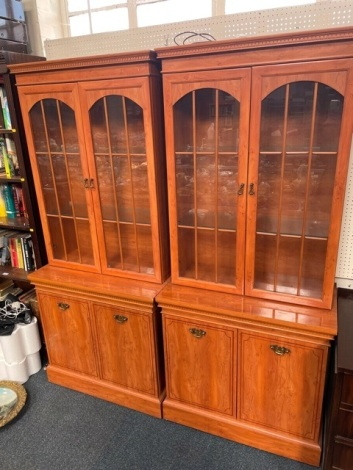 Two yew wood display cabinets.