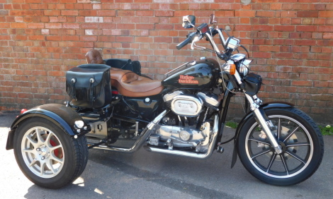 A Harley-Davidson trike, D405 UGF, a 1989 first registered 1987 manufacture machine, 1100cc petrol engined 3-wheeler, currently SORN and with an MOT expired on 2nd January 2021 and an odometer reading showing of 3,240 miles. To be sold upon instructions f