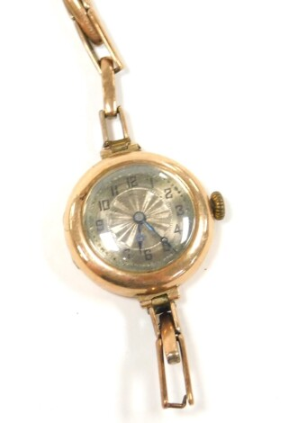 A wristwatch, with small circular silvered coloured dial in a yellow metal case, marked 375, on an expanding 9ct gold on silver bracelet, (AF), 18.8g all in.