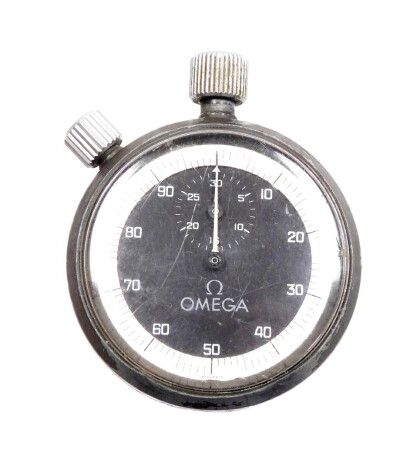 An Omega steel cased stop watch, the black dial with white outer border, inscribed to back E M G A S 54, 5cm diameter.