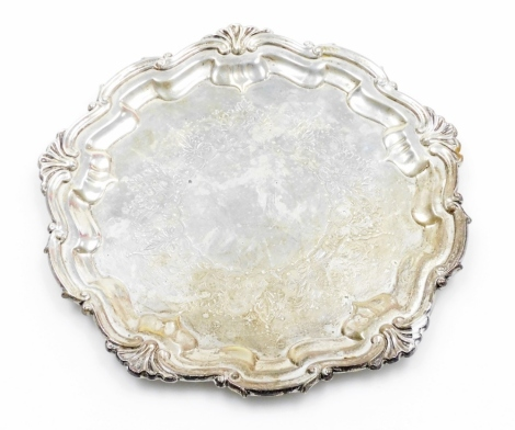 A George V silver salver, with Chippendale moulded raised border and partially engraved to the centre, Birmingham 1910, 20cm wide, 8.2oz.