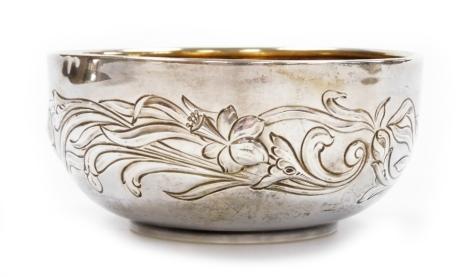 An Edwardian Art Nouveau silver bowl, with repoussé decoration of flowers and leaves, Chester 1905, 12cm diameter, 4.2oz.