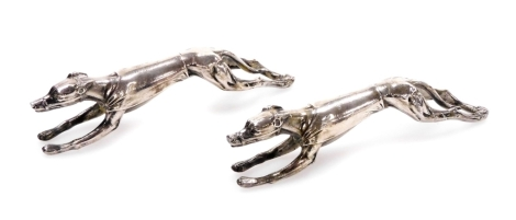 A pair of early 20thC novelty silver plated greyhound knife rests, of outstretched running form, 9cm long, marked beneath. (2)