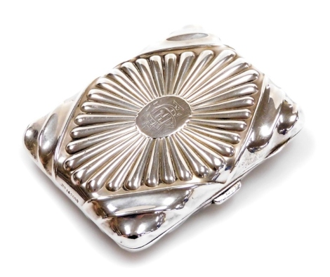 A Victorian silver presentation cigarette case, marked to the interior '220 London Road, Leicester', maker S I Ltd, repoussé decoration and diamond decoration with engraved central cartouche and moulded handles, silver gilt interior, Birmingham 1892, 9cm,