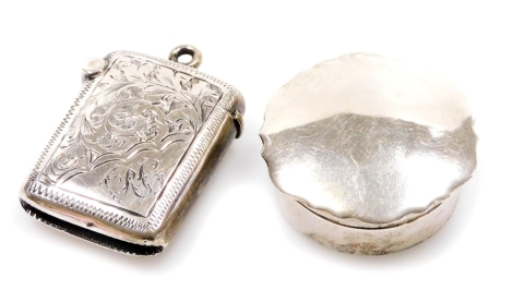 A late Victorian miniature vesta case, engraved with scrolls and flowers, with silver gilt interior and match strike base, with fixed ring top, Birmingham 1899, 4cm, and a silver pill box, 0.7oz all in. (2)