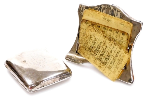 An Edwardian silver cigarette case, with rounded corners, strap work interior and monogram to the lid, Birmingham 1901, 9cm, and a part Art Deco desk calendar with oak easel back and removable date cards, 6.5oz all in. (2 AF)