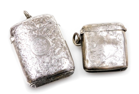 A Victorian silver vesta case, heavily decorated with scrolls with an monogram cartouche and striker base, Birmingham 1898, and a further vesta case, 2oz. (2)